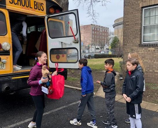 Photo of Franklin students unloading boxes from bus