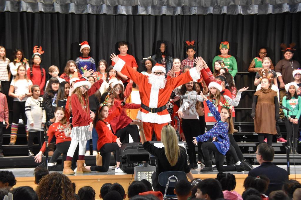 Students surround Santa Claus