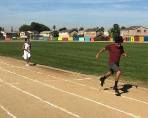 A 7th grade student running his race at the FMEA Track Meet.