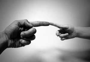 Photo of man's hand and child's hand
