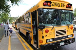 Image of bus parked at a school