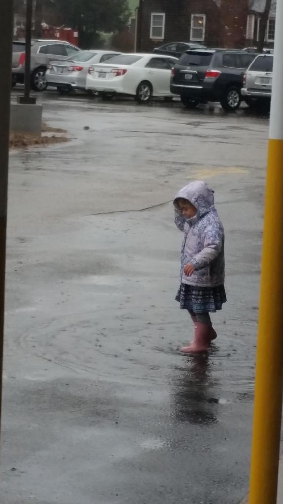 Child in Rain puddle