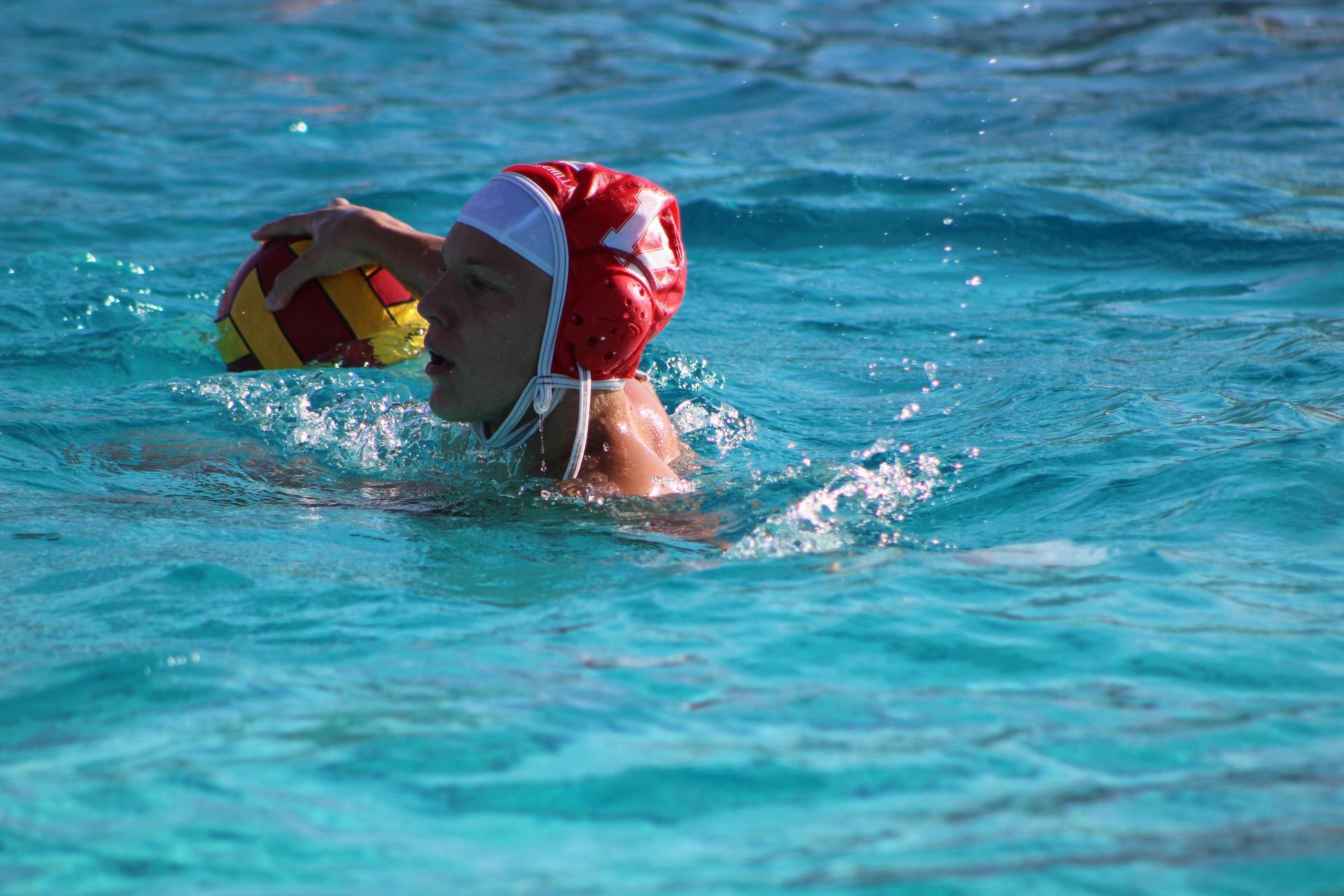 Boys playing water polo vs Fresno