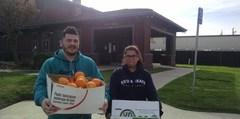 KCHS Students delivering fruits from our garden to a local community