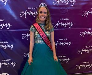 Sarah Triolo poses with her Miss Amazing sash and crown.