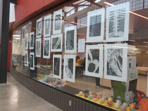 TKHS student artwork is displayed on windows of the art rooms.