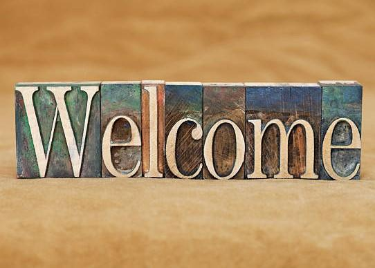 The word WELCOME in rustic wooden blocks