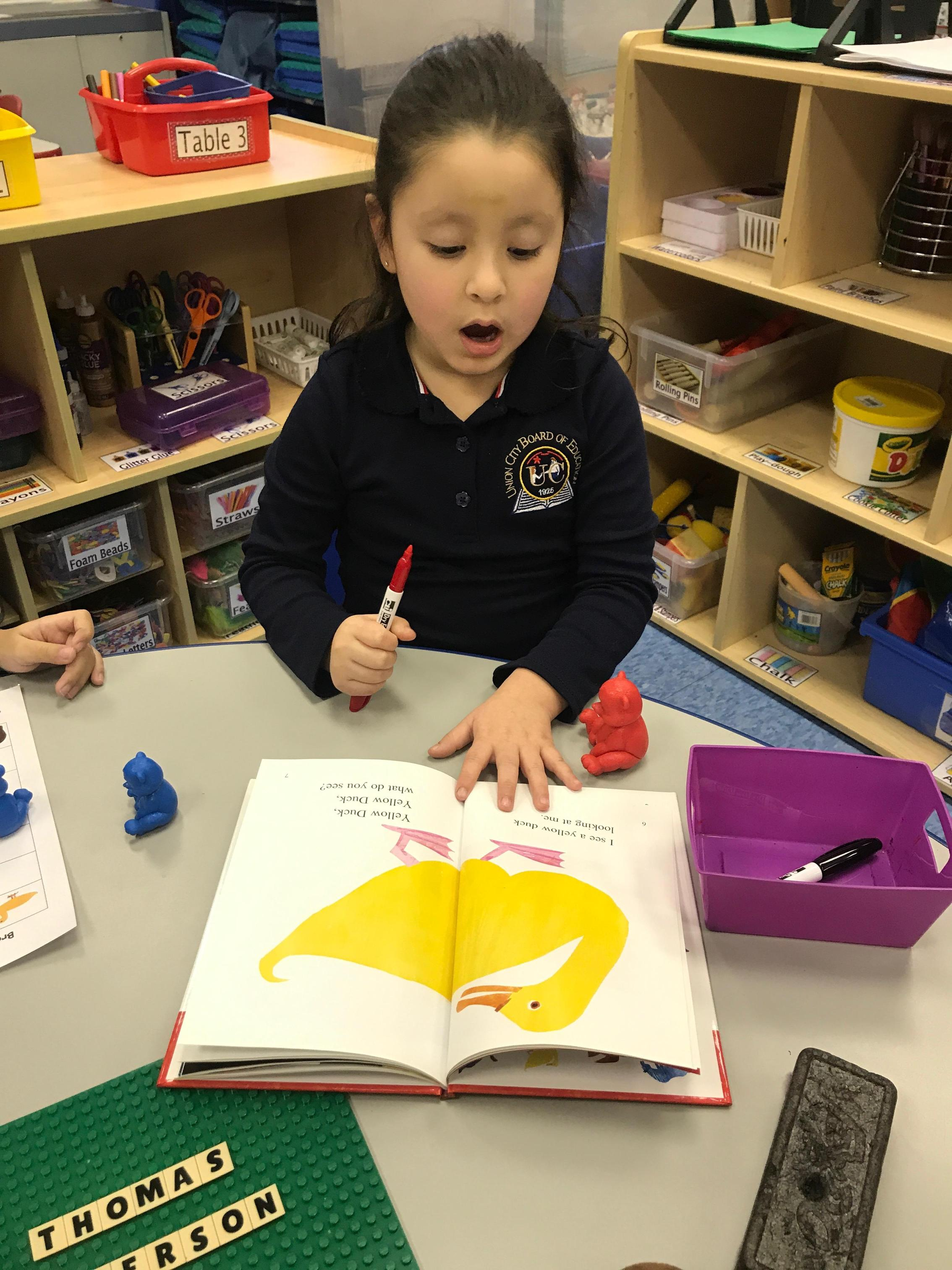 Student reading the story.