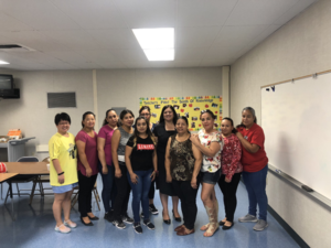 parents posing for a picture with new principal Sandra Campos