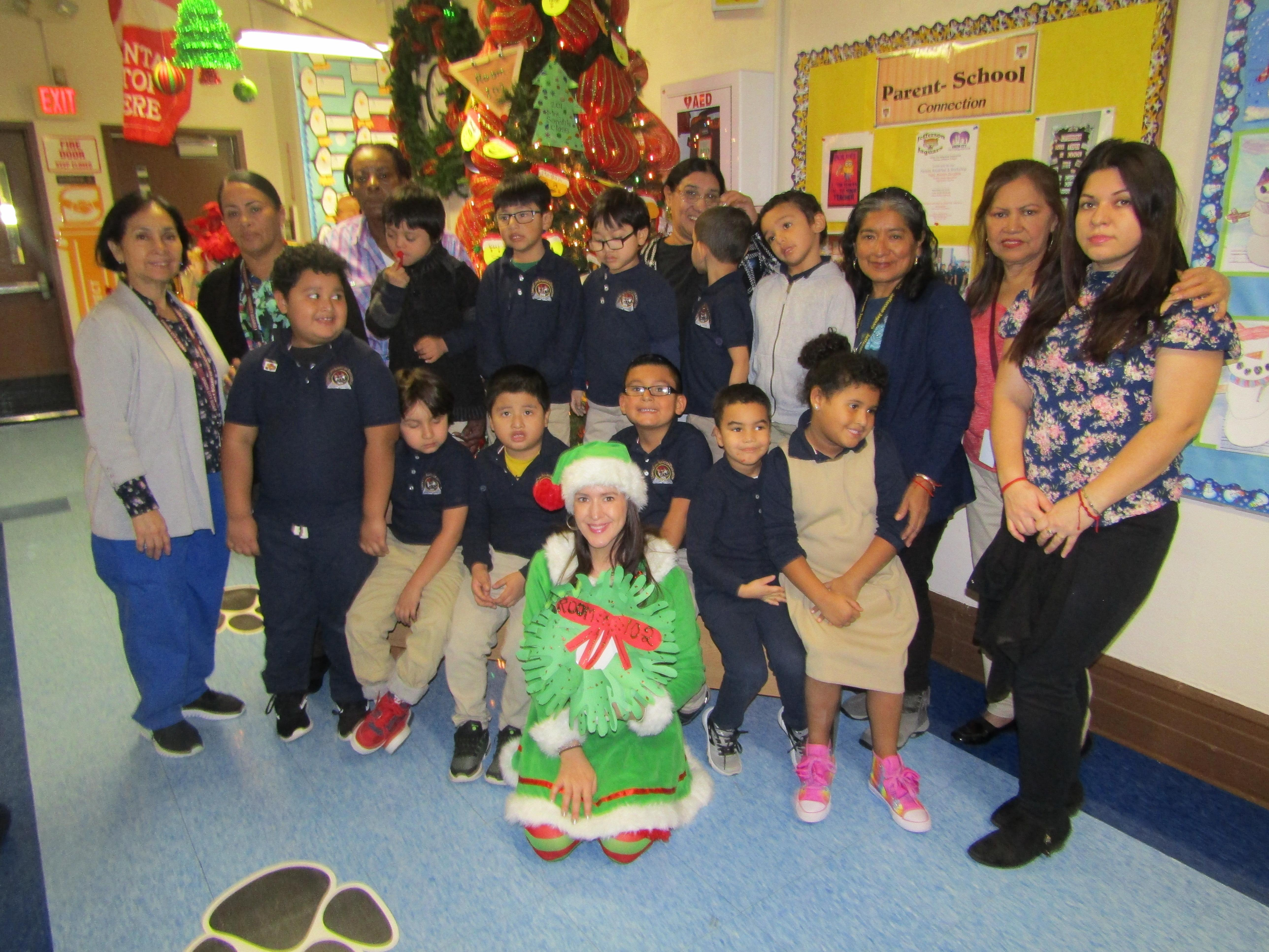 4th grade class with students and aides in front of the christmas tree