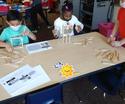 children building towers with Keva planks