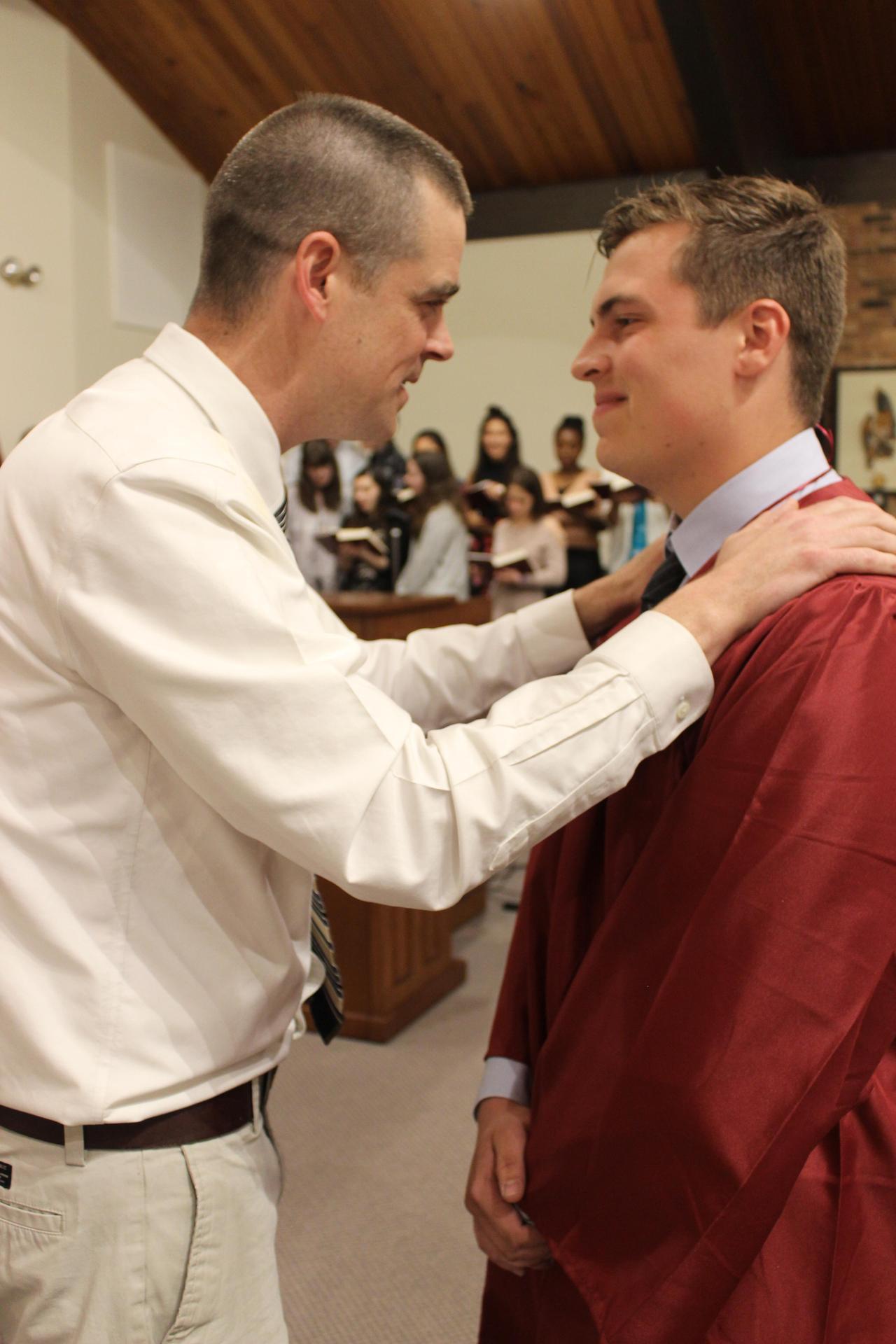 Mr. Morrison with graduate