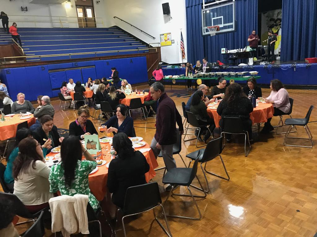 staff enjoying the thanksgiving luncheon in the gymnatorium