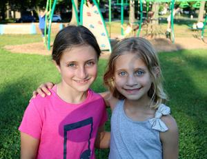 Two Jefferson School sisters enjoy a Summer Social with friends and families.