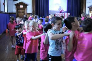Photo of  8th Annual McKinley-Thon when students and staff dance to raise money for pediatric cancer research.