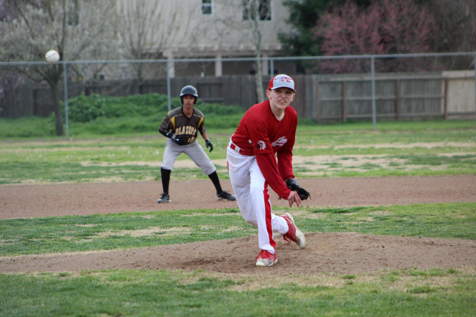 JV baseball players in action against Golden West