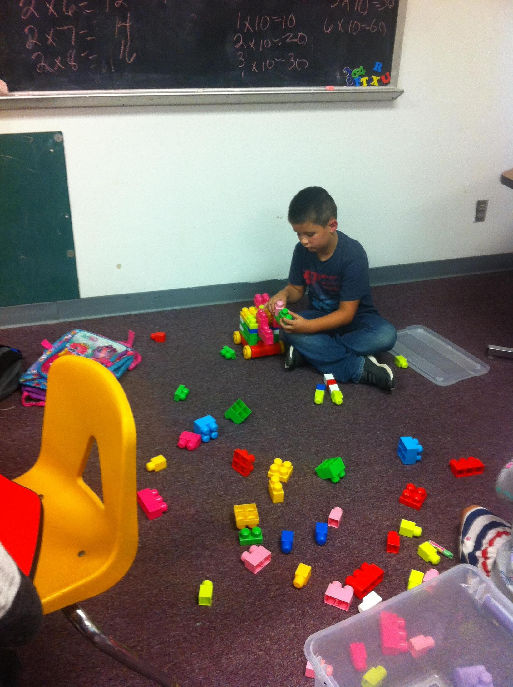 Student building with blocks.