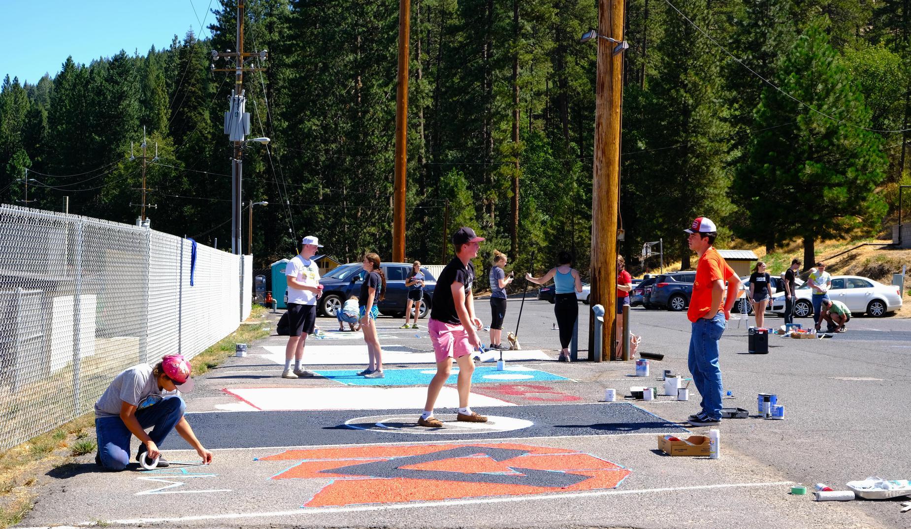 qhs seniors painting parking spaces