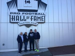 Commissioner Valdivia and the bus drivers in front of the hall of fame building
