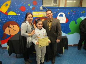 proud mom and her daughter showing off her certificate with principal mr. celebrano