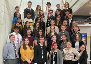 Business Professionals of America students pose in the school stairway.