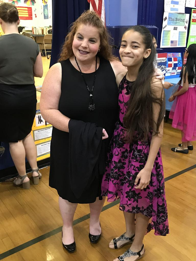 5th grade teacher and female student smiling