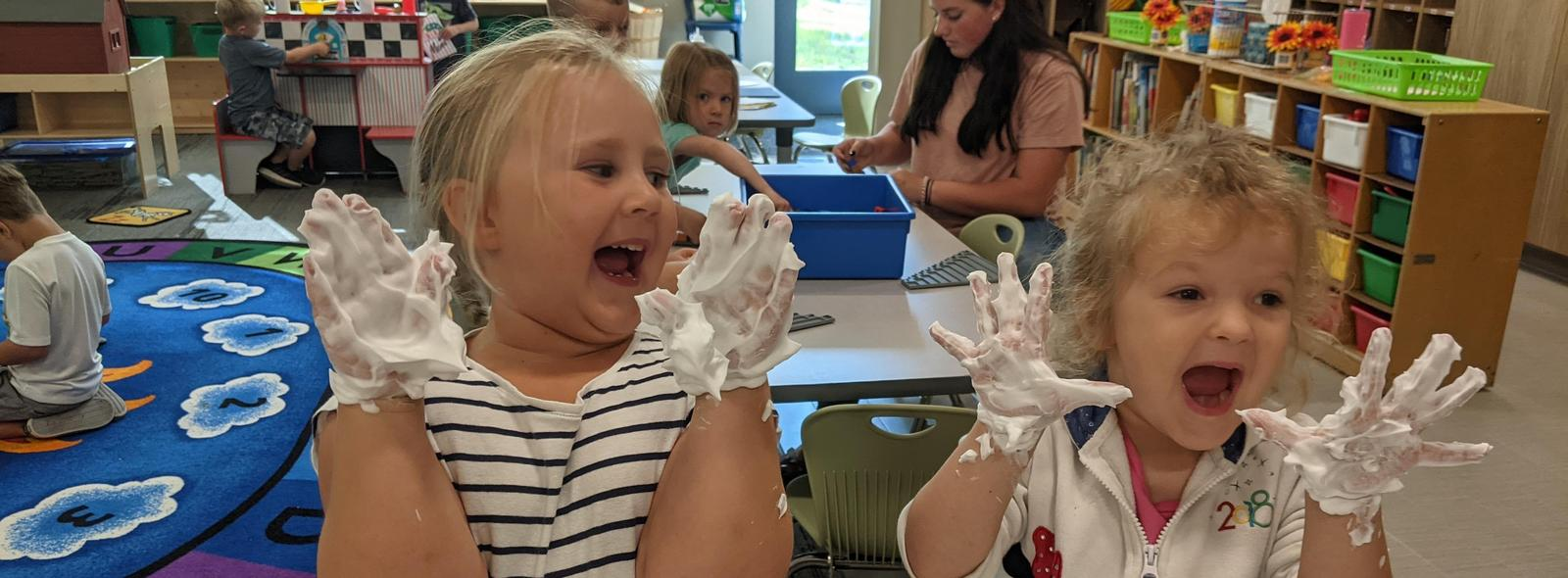students laughing with shaving cream on their hands