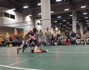 a picture of two boys wrestling