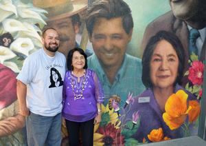 Dolores Huerta with local artist, Lonnie Lopez, in front of his new mural featuring her at Grace Hudson Elementary.