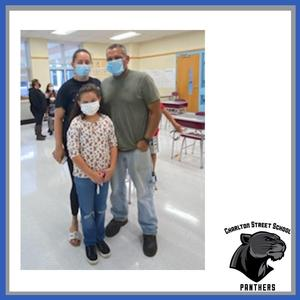 A family at Charlton Street Elementary School open house