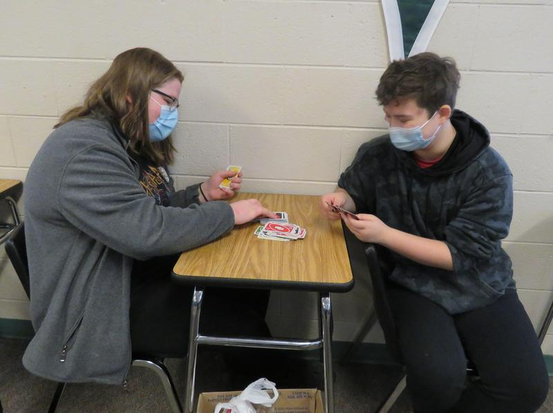 TKHS students play cards during a mental wellness day activity.