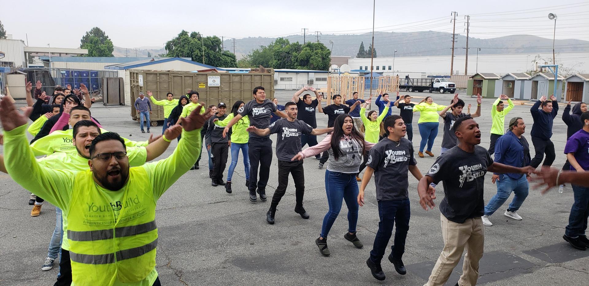 LA CAUSA students do jumping jacks