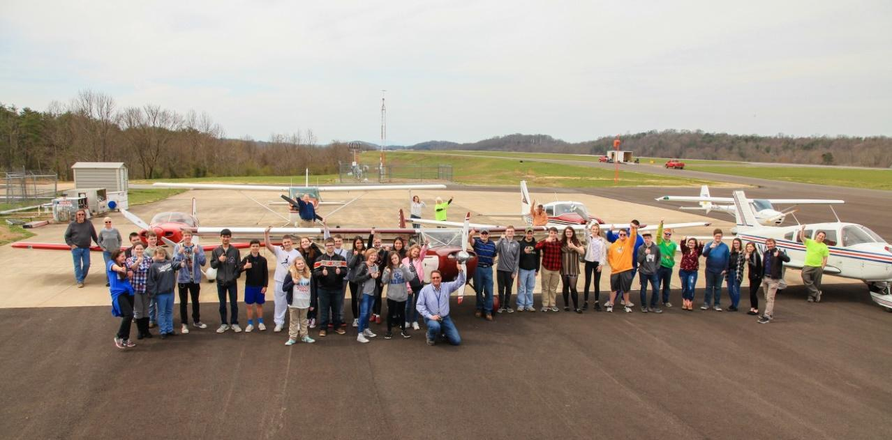 Large group of young airport users