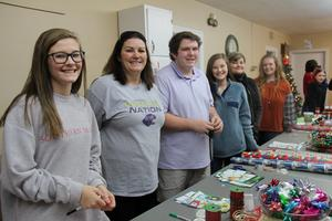 Volunteers from St. John's United Methodist Church prepare to wrap gifts that were selected by members of the Lexington Three Mentoring Program for their family members at the 17th annual Santa's Closet event on Sunday, December 8th.