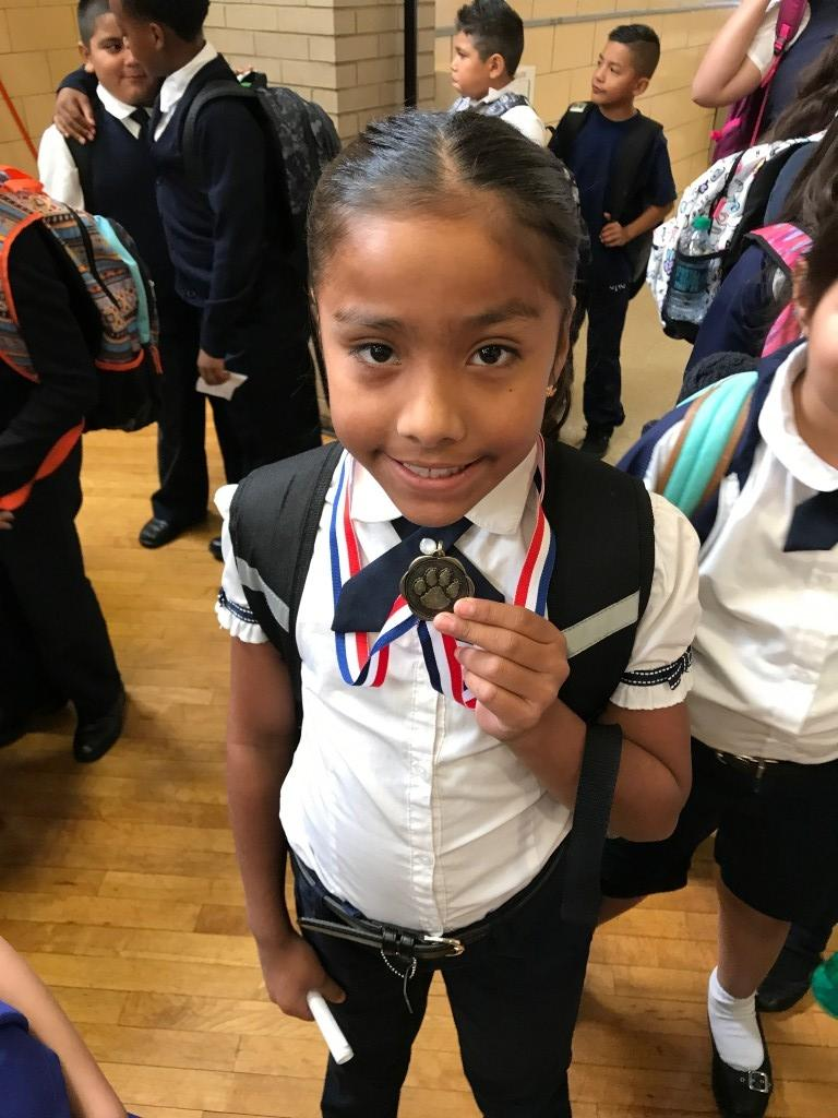 Students smiling with her medal