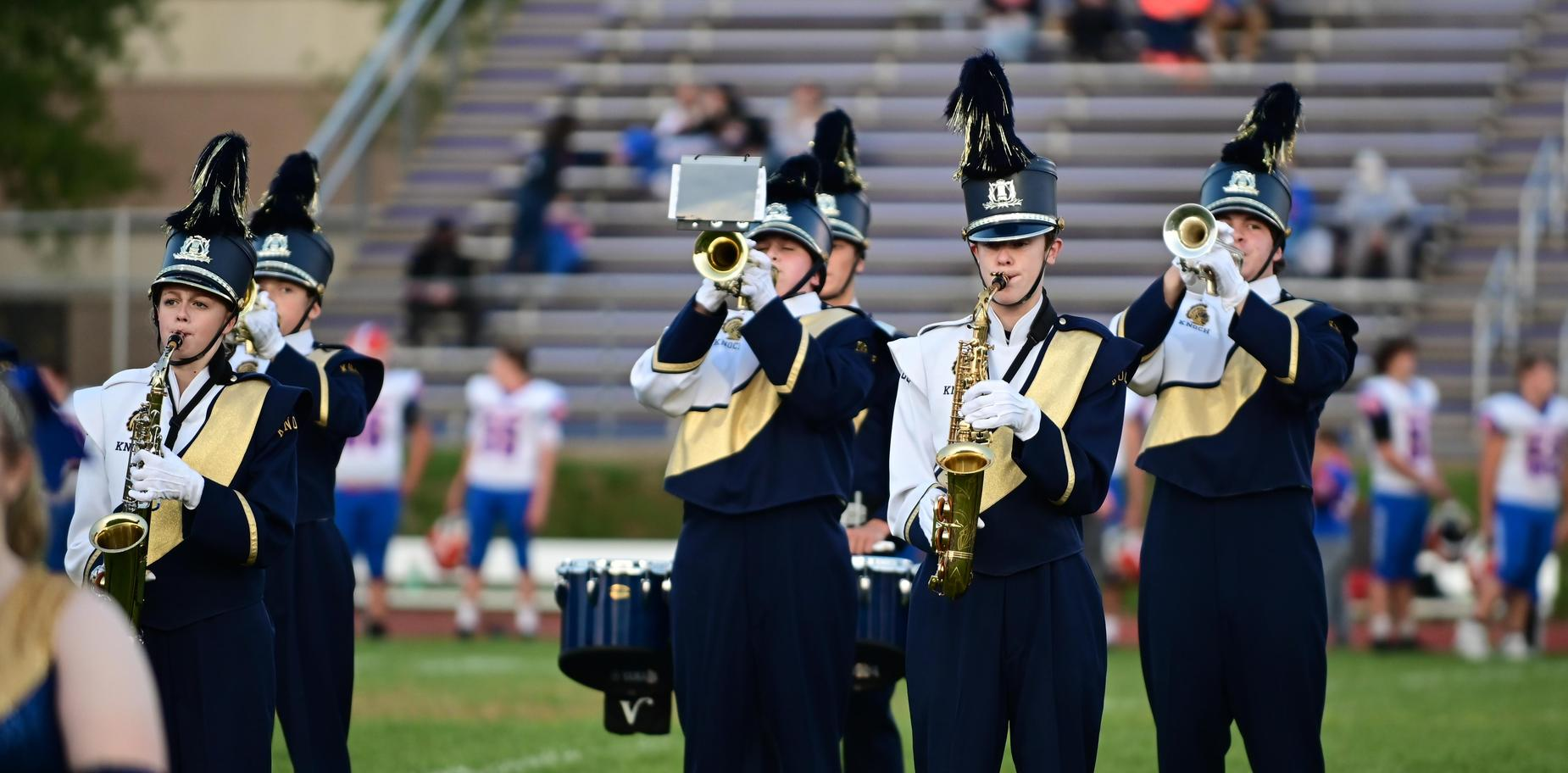 marching band musicians performing on field