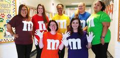 3rd grade teachers dressed up like MnMs