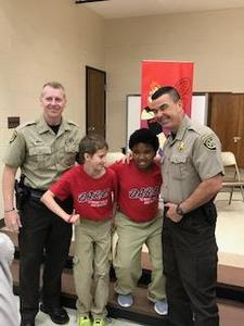Sheriff Simmons and Deputy Cook with students.