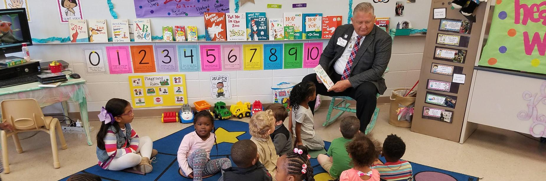 Mr. Moore reading to ecc students