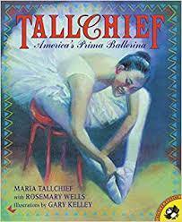 ballerina tying her ballet shoes