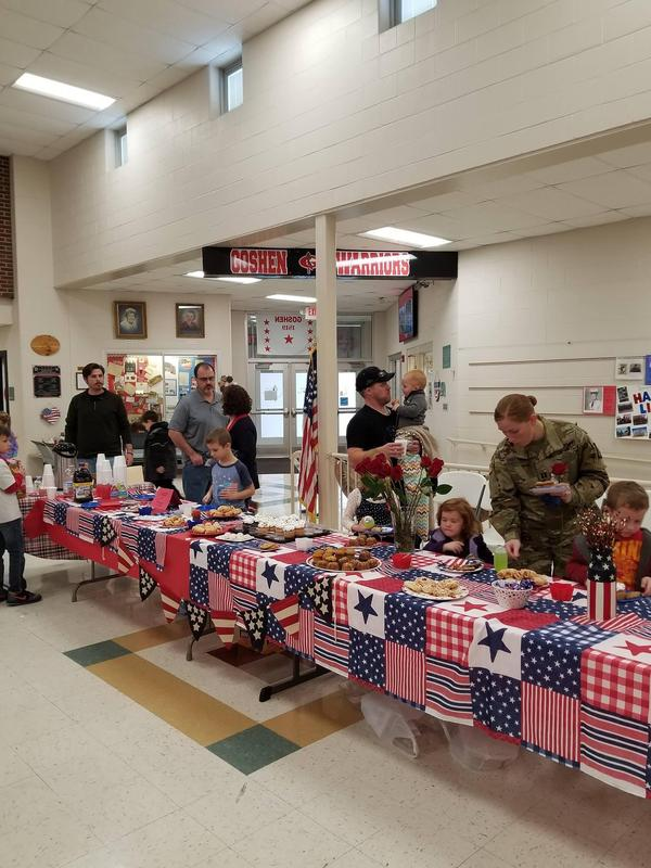 Veterans and students at school getting refreshments