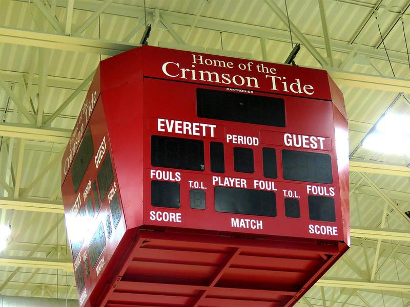 The scoreboard hanging from the ceiling inside the EHS gymnasium