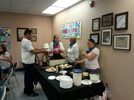 PTSA board members serving up some pancakes and sausage