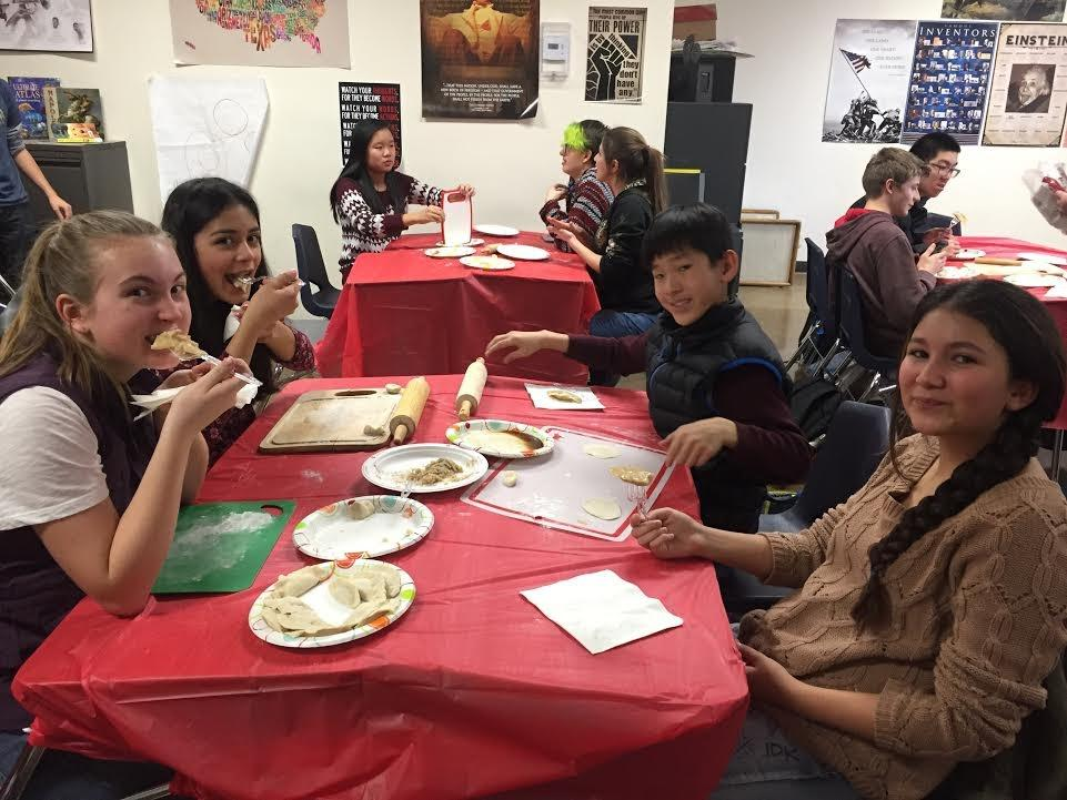 Students in a foreign language class eating traditional foods