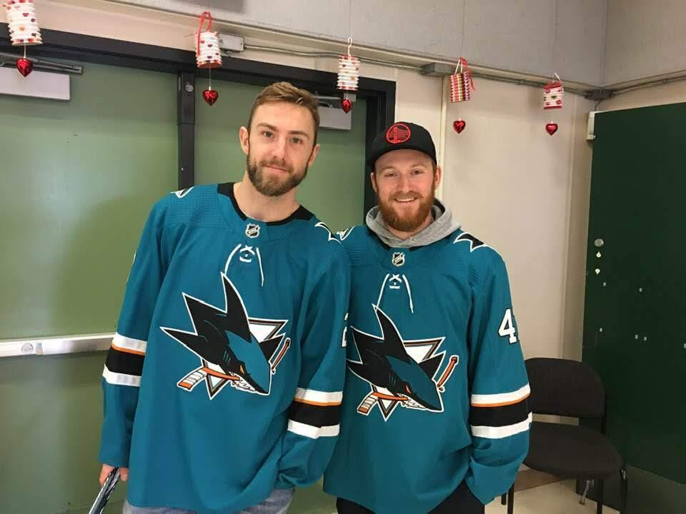 two sharks players smile for the camera