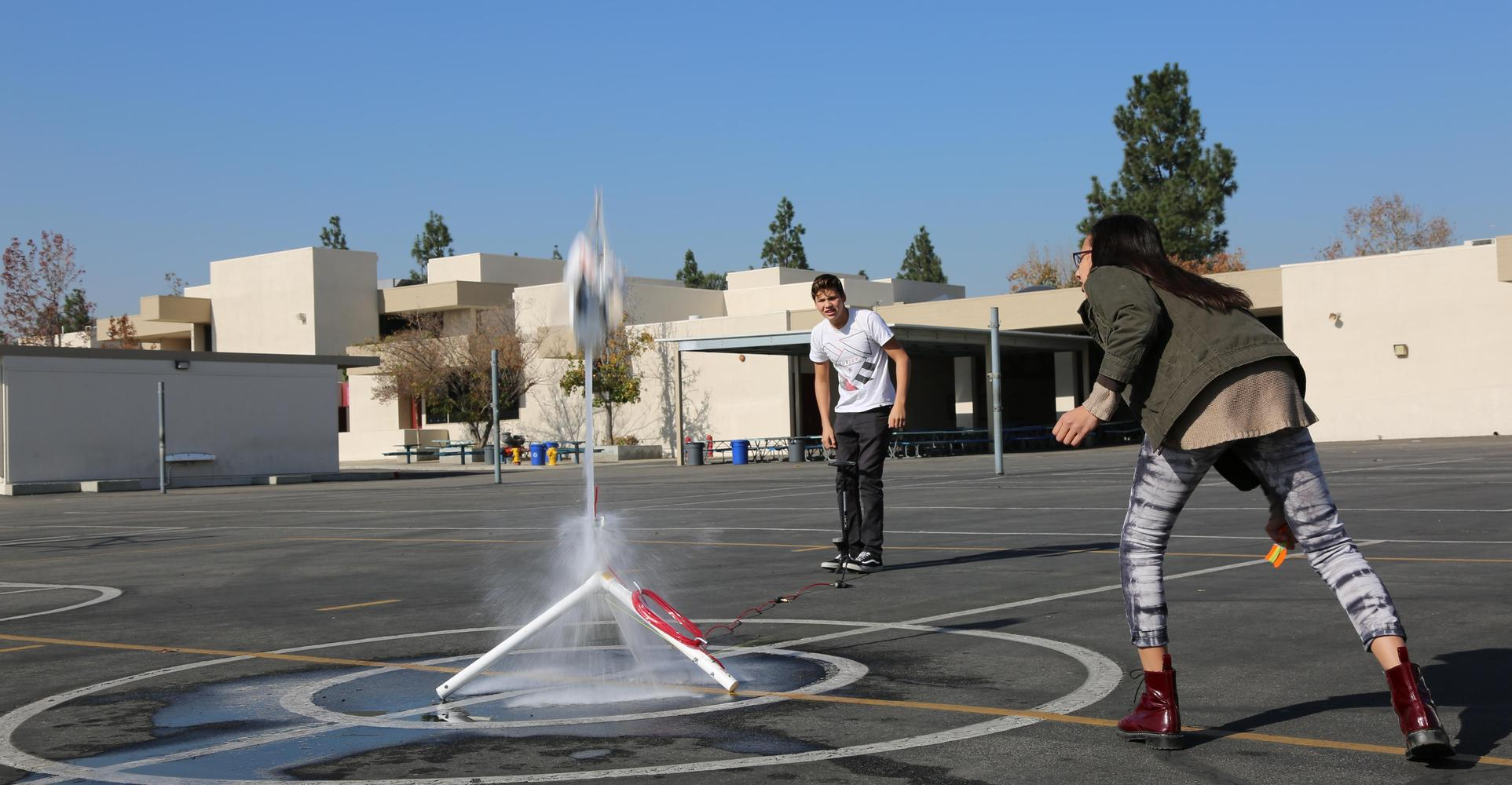 Students launch rocket.