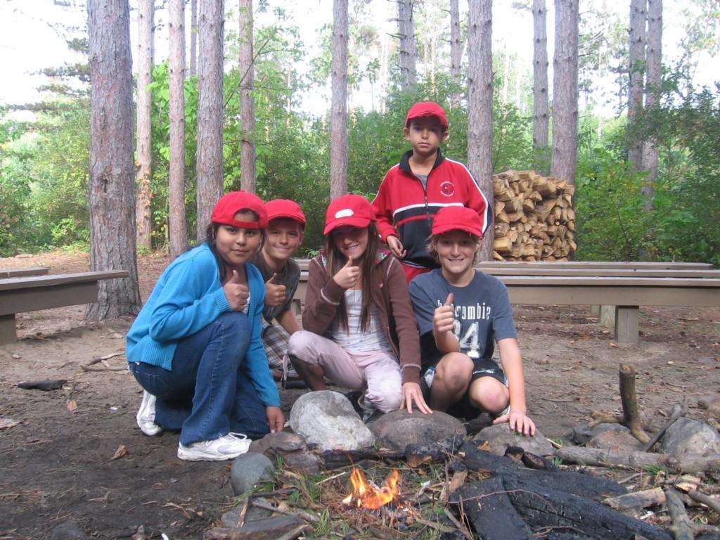 kids celebrate building a fire outside