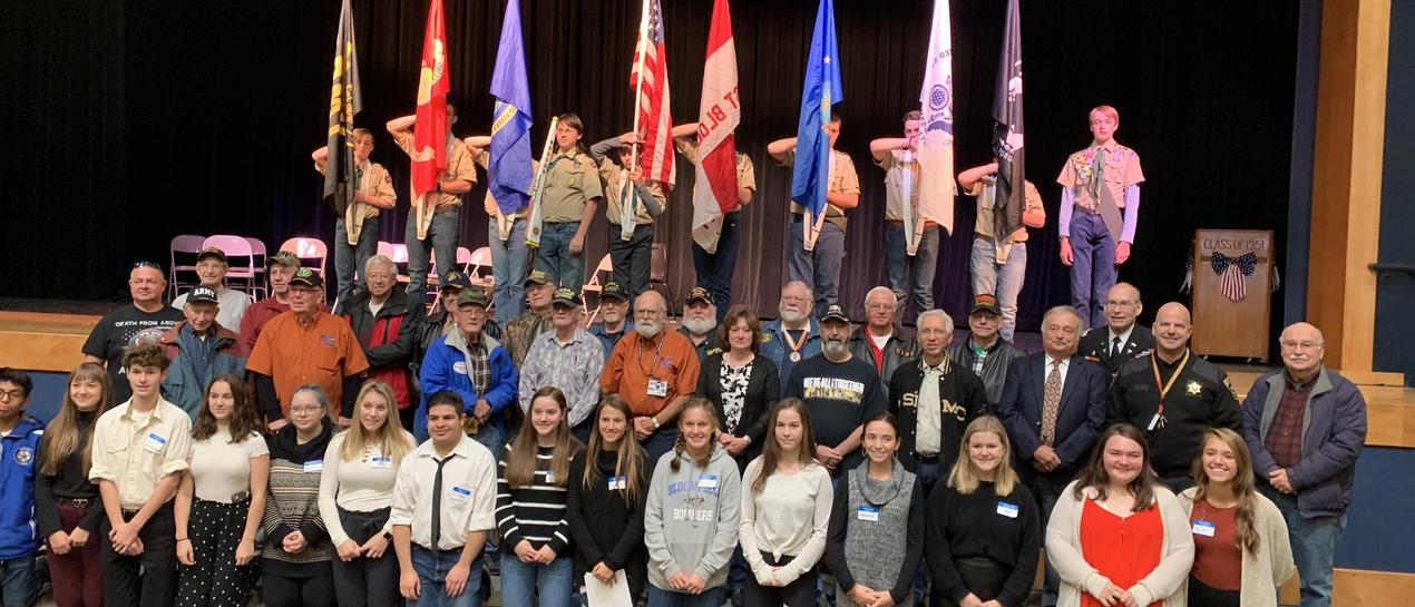 picture of boy scouts, veterans, and students