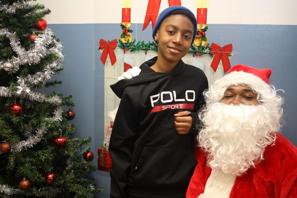 Smiling student with Santa