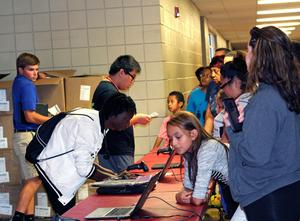 ACS staff, students and families at the HMS Chromebook rollout 2018
